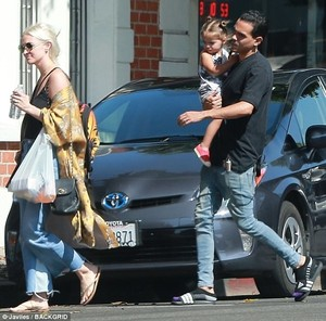 43CD41D400000578-4845628-Happy_anniversary_The_happy_couple_strolled_to_their_vehicle_as_-m-60_1504307036057.jpg